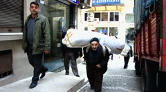 Turkey Istanbul old town Sultanahmet porter carrying luggage uphill Stock Footage