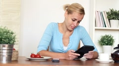 Young attractive woman reading book on digital ebook reader, dolly shot - stock footage
