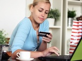 Young happy woman shopping online with laptop NTSC Stock Footage
