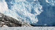 View of Glacier calving from nearby glacier Stock Footage