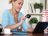 Young happy woman shopping online with tablet computer NTSC Stock Footage