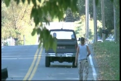 Truck going down country road Stock Footage