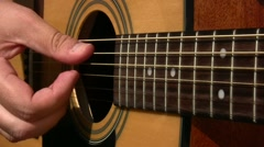 Acoustic guitar playing - stock footage