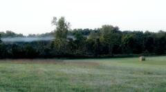Stock Footage - Myst Mist at sunrise on a farm - Low lying Stock Footage