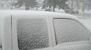 Stock Video Footage of snow coverd car - brush snow off broom