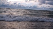 Stock Video Footage of Waves at lake Michigan beach and sun reflection