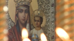 Icon of the Virgin Mary with baby Jesus in an orthodox temple - stock footage