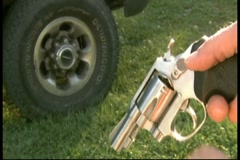 Loading one bullet into pistol revolver Stock Footage