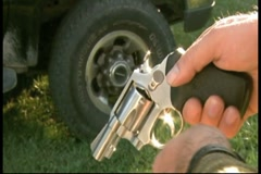 Loading a Rossi revolver and spinning cylinder Stock Footage
