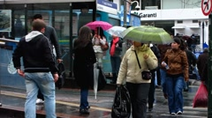 Turkey Istanbul old town tram station pedestrians in rain Stock Footage