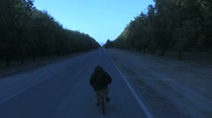 Biking Cold Down the Road Stock Footage