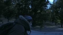 Biking Cold Tree Orchard II Stock Footage