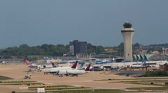 Shot of tarmac, control tower, terminal and several planes Stock Footage