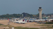 Stock Video Footage of Shot of tarmac, control tower, terminal and several planes