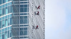 Window washers on skyscraper Stock Footage