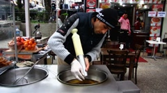 Turkey Istanbul frying Churros in hot oil Stock Footage