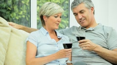 Middle Aged Couple at Home Drinking Red Wine Stock Footage