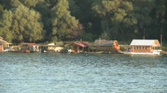 Houses on a river Stock Footage