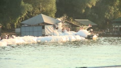 Foam party on a river Stock Footage