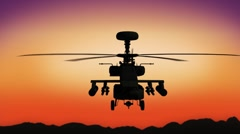 Apache helicopter in the sky during sundown Stock Footage