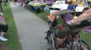 Stock Video Footage of People walking down sidewalk at Craft Fair. (4 of 4)