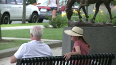 Sitting on a bench next to a monument. Stock Footage