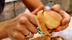 Young woman peeling potatoes Stock Footage