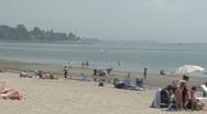 Stock Video Footage of People enjoying the beach under umbrellas. (3 of 4