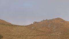Hikers on a ridge line Stock Footage