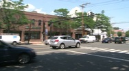 Stock Video Footage of Traffic driving through downtown. (2 of 4)