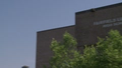 Name of a high school on the front of the building. - stock footage