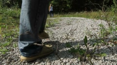 Male walking on rocky path Stock Footage