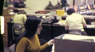 Stock Video Footage of Office Workers BANK EMPLOYEES TELLER 1970 (Vintage Film Home Movie) 614