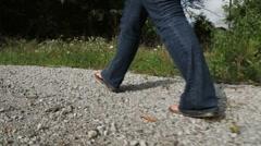 Female walks on rocky path Stock Footage