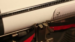 "Closeup of the words ""economic slowdown"" written on a typewriting machine Stock Footage"
