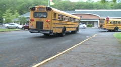 Buses leave the school (1 of 3) Stock Footage
