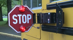 Bus stop sign with hazard lights on. (3 of 5) Stock Footage