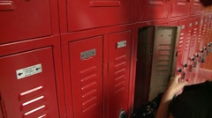 A student using her locker. Stock Footage
