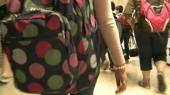 Students going through hallway with backpacks on. - stock footage