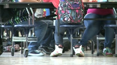 Students waiting in cafeteria (2 of 2) - stock footage
