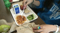 Students eating school bought lunch.  (1 of 2) - stock footage