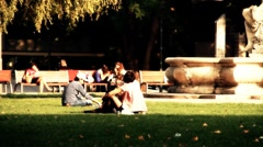 Young People in a Park stylized artsoft filmlook Stock Footage