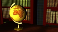 Old globe in a classic library Stock Footage