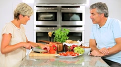 Healthy Mature Couple Preparing Salad for Lunch Stock Footage