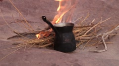 Heating water for tea in desert: cooking Stock Footage