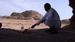 Man makes tea in desert Stock Footage