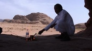 Stock Video Footage of man makes tea in desert
