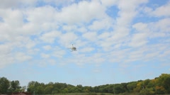 Helicopter fly in the blue sky - stock footage