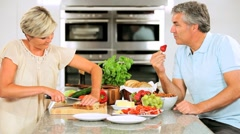 Mature Couple Preparing Healthy Lunch Stock Footage