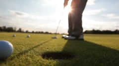 Man striking ball at the golf course Stock Footage